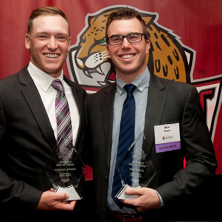 Two men pose with their awards.