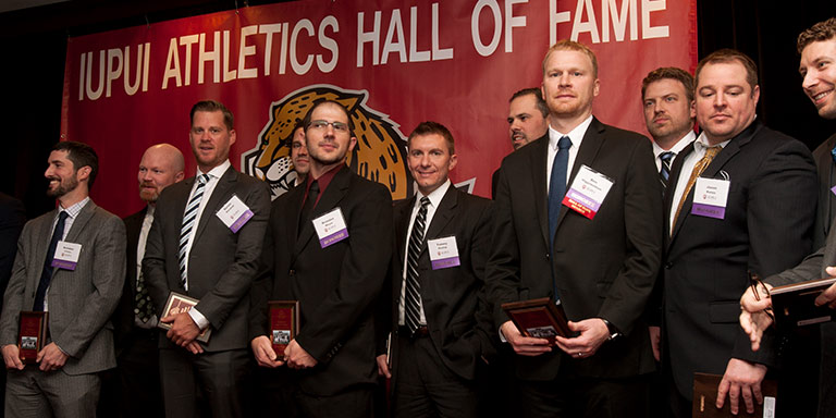 Several men pose with their awards.